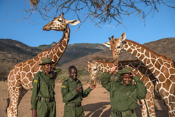 Local keepers from the Samburu, part of the Namunyak Community Conservancy in Northern Kenya,  rescue, rehabilitate and reintroduce orphaned or abandoned elephant calfs, giraffe, kudu, gerenuk, and other species back  into the wild. (Photo by Ami Vitale)