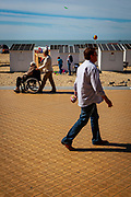 Walking on the promenade. Beach huts, Ostend, coastal city in Belgium