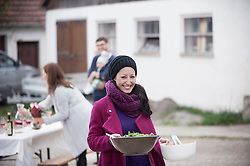 Mid adult woman holding salad bowl at farmhouse, Bavaria, Germany