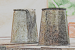 Tin cups sitting on a wooden table