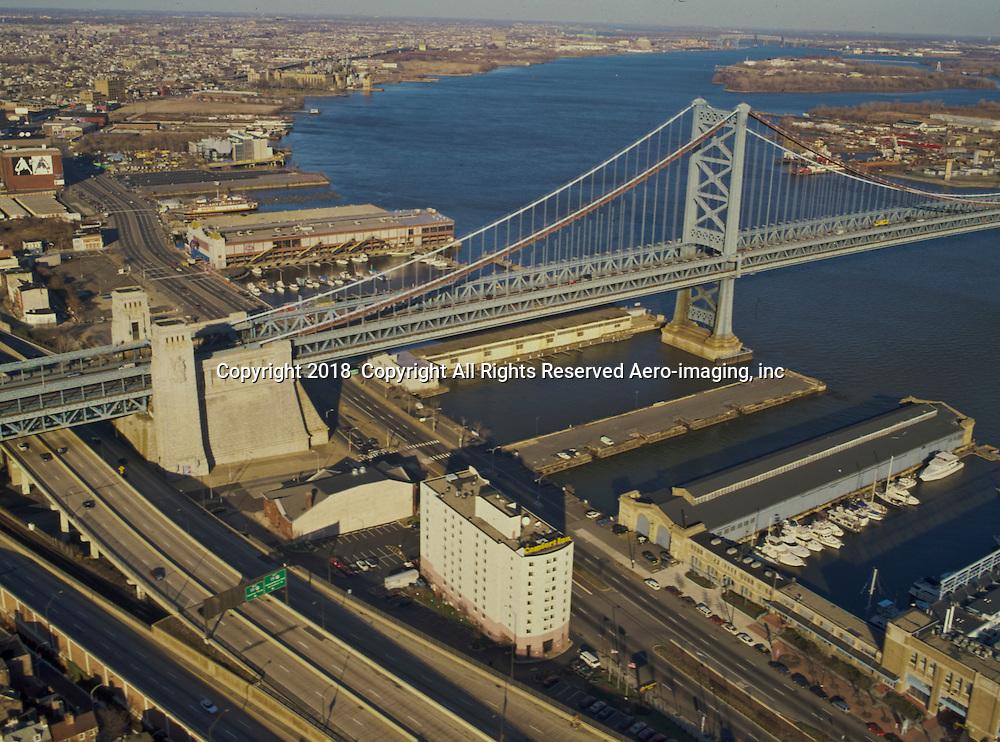 Aerial view of Benjamin FRANKLIN BRIDGE and Route 95, 676 Highway, Penns Landing Hilton Hotel.