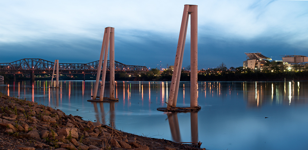Piers are seen along the Kentucky side of the Ohio River at dusk just across from Cincinnati, OH.