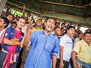 03 NOVEMBER 2012 - HAT YAI, SONGKHLA, THAILAND:    Spectators watch a bullfight at the bullfighting arena in Hat Yai, Songkhla, Thailand. Bullfighting is a popular past time in southern Thailand. Hat Yai is the center of Thailand's bullfighting culture. In Thai bullfights, two bulls are placed in an arena and they fight, usually by head butting each other until one runs away or time is called. Huge amounts of mony are wagered on Thai bullfights - sometimes as much as 2,000,000 Thai Baht ($65,000 US).    PHOTO BY JACK KURTZ