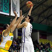 Anadolu Efes's Kerem Gonlum (R) during their Turkish Basketball League match Anadolu Efes between Olin Edirne at the Ayhan Sahenk Arena in Istanbul, Turkey on Sunday, 17 March, 2013. Photo by TURKPIX