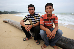 Gifari Jakawali  (arie) 20 in red t shirt and Bahagia Rahmatullah  (Rahmat) 16. 7 months on the beach where the huge wave came ashore.  These two boys were photographed in 2004 at home in Lho-Nga just following by the Indian Ocean tsunami, Aceh Province, Sumatra, Indonesia