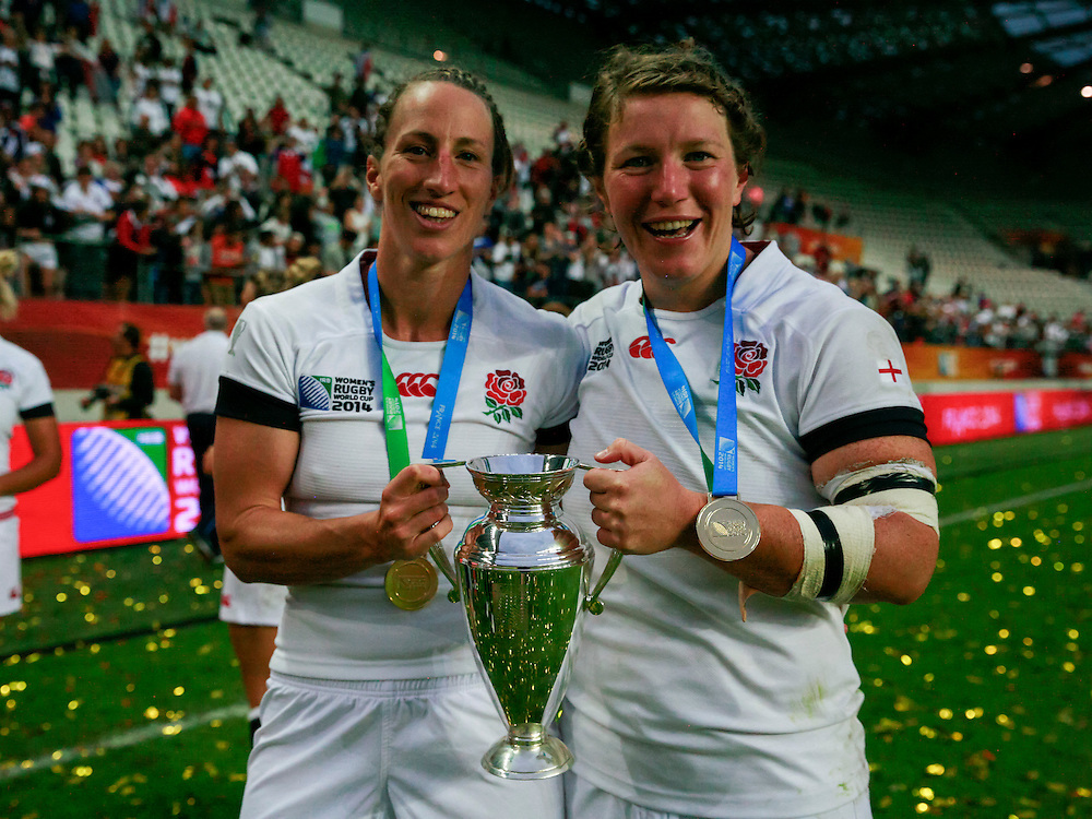 Kat Merchant and Rochelle Clark post match with their gold medals and the cup. WRWC England v Canada, World Cup Final at Stade Jean Bouin, Avenue du Général Sarrail, Paris, France, on 17th August 2014