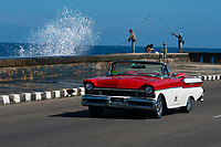 Classic Car, Malecon, Fisherman, Waves, Havana Cuba 2020 from Santiago to Havana, and in between.  Santiago, Baracoa, Guantanamo, Holguin, Las Tunas, Camaguey, Santi Spiritus, Trinidad, Santa Clara, Cienfuegos, Matanzas, Havana