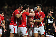 Alex Cuthbert of Wales © celebrates his try with Mike Phillips (r). RBS Six nations championship 2012, Wales v Scotland at the Millennium Stadium in Cardiff on Sunday 12th Feb 2012.  pic by Andrew Orchard, Andrew Orchard sports photography,