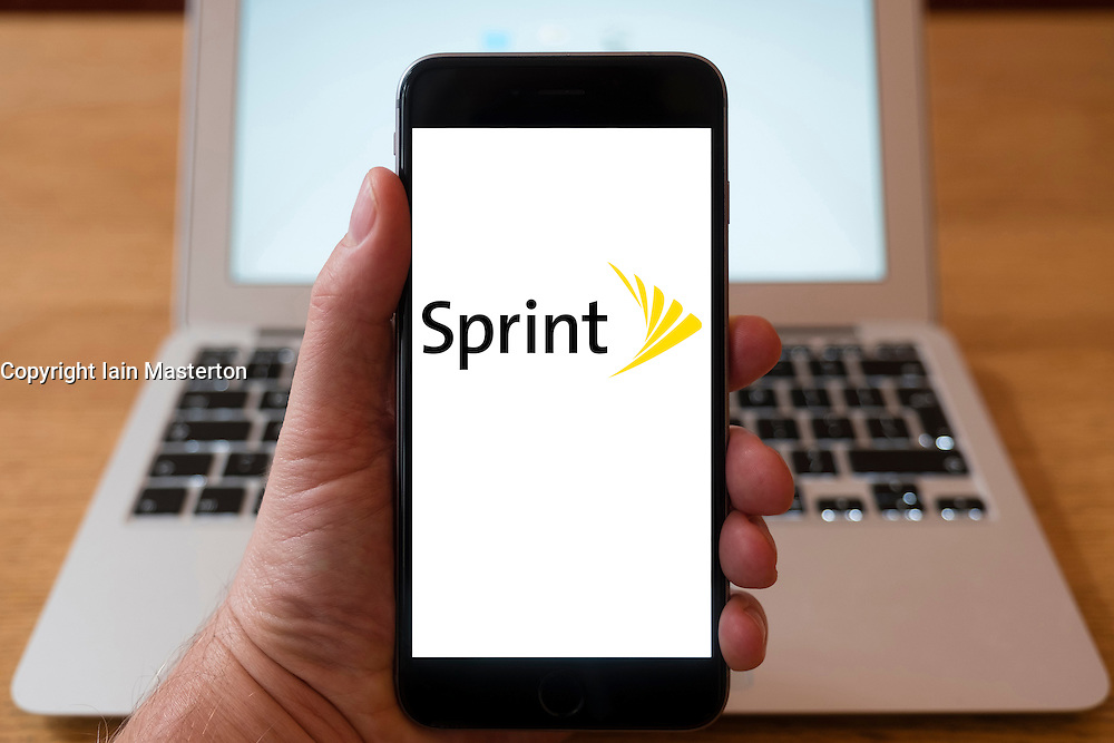 Using iPhone smartphone to display logo of Sprint American telecommunications company