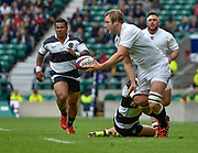 England lock Joe Launchbury (Wasps) off-loads as Barbarians prop Matias Diaz (Pampas & Argentina) brings him to ground during the International Rugby Union match England XV -V- Barbarians at Twickenham Stadium, London, Greater London, England on May  31  2015. (Steve Flynn/Image of Sport)