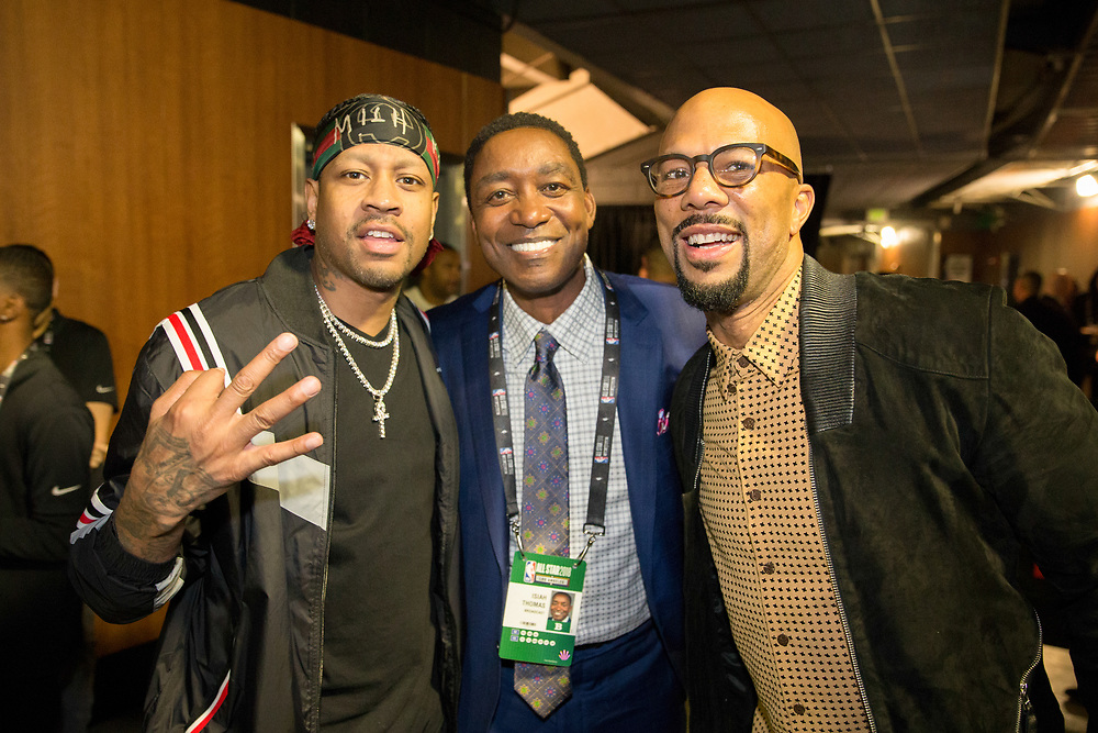 Allen Iverson, Isiah Thomas, and Common pose for a photo.