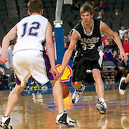 2/11/06 -- Omaha, Ne.Battle Creek Ida Groves Casey Harriman looks to maneuver around  Blair's  Jason Trulin at The Omaha Shootout, a High School Basketball tournament featuring some of the best prospects at the Qwest Center Omaha...(Photo by Chris Machian/Prarie Pixel Group).