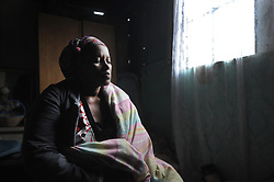 South Africa - Cape Town - 21 June 2020 - Mandulele Quku, mother of murdered teenager Amahle Quku, sits on her bed and cries. Amahle Quku, 17, was found murdered in Albert Luthuli Street, Brown's Farm. Her naked body was discovered shortly after 7am on Saturday at a house in the street. Police said they are trying to determine the cause of her death and were searching for possible suspects. Photographer: Armand Hough/African News Agency(ANA)