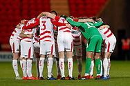Doncaster Rovers huddle up during the EFL Sky Bet League 1 match between Doncaster Rovers and Southend United at the Keepmoat Stadium, Doncaster, England on 12 February 2019.