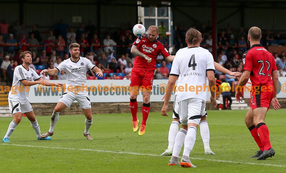 Crawley's Mark Connolly heads towards goal during the Friendly match between Aldershot Town and Crawley Town at the EBB Stadium in Aldershot. July 30, 2016.<br /> James Boardman / Telephoto Images<br /> +44 7967 642437