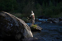 Guide, Drew Price hooked up, fighting a landlocked salmon in the Clyde River, Newport, Vermont