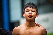 28 JULY 2013 - BANGKOK, THAILAND:  Blood streams down a boxer's face during the ASEAN Muay Thai Championship at MBK shopping center in Bangkok. His bout was called because of the cut.      PHOTO BY JACK KURTZ