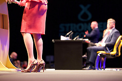 Nicola Sturgeon, referencing Theresa May, joked that she would not be able to dance on to the stage 'in these shoes' at the SNP annual conference in Glasgow. pic copyright Terry Murden @edinburghelitemedia