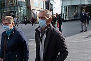 With new local coronavirus lockdown measures now in place and Birmingham currently set at 'Tier 2' or 'high', people wearing face masks continue to come to the city centre on 14th October 2020 in Birmingham, United Kingdom. This is the first day of the new three tier system in the UK which has levels: 'medium', which includes the rule of six, 'high', which will cover most areas under current restrictions; and 'very high' for those areas with particularly high case numbers. Meanwhile there have been calls by politicians for a 'circuit breaker' complete lockdown to be announced to help the growing spread of the Covid-19 virus.
