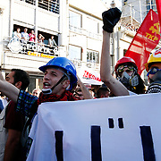 Protesters chant before clashes on Istiklal Avenue in Istanbul, Turkey, on July 6, 2013. Riot police fired tear gas and water cannon on July 6 to disperse some 3,000 demonstrators who tried to enter flashpoint protest spot Taksim Square in Istanbul. The group had gathered on the Istiklal Avenue pedestrian way that leads to the square, the site of nearly three weeks of protests against Prime Minister Recep Tayyip Erdogan and his Islamic-rooted government that left four people dead and some 8,000 injured. Photo by AYKUT AKICI/TURKPIX