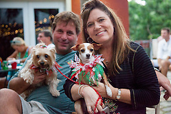 """Leah Browning, with dog """"Sugar Daisy"""" adopted two years ago from the Humane Society and Cpt. Scott Browning with Cinnamon.  Christmas Tree Lighting and Seasonal Fundraiser for the Humane Society of St. Thomas.  St. Thomas, USVI.  11 De© Aisha-Zakiya Boyd"""
