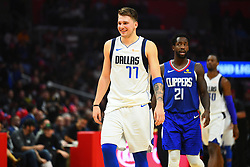 December 21, 2018 - Los Angeles, CA, U.S. - LOS ANGELES, CA - DECEMBER 20: Dallas Mavericks Guard Luka Doncic (77) is all smiles during a NBA game between the Dallas Mavericks and the Los Angeles Clippers on December 20, 2018 at STAPLES Center in Los Angeles, CA. (Photo by Brian Rothmuller/Icon Sportswire) (Credit Image: © Brian Rothmuller/Icon SMI via ZUMA Press)