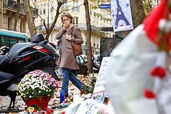 © Licensed to London News Pictures. 17/11/2015. Paris, France. Mourners visit a memorial outside La Belle Équipe cafe in Paris, France following the Paris terror attacks on Tuesday, 17 November 2015. Photo credit: Tolga Akmen/LNP
