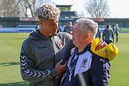 Charlton Athletic attacker Lyle Taylor (9) talking with member of AFC Wimbledon groundstaff during the EFL Sky Bet League 1 match between AFC Wimbledon and Charlton Athletic at the Cherry Red Records Stadium, Kingston, England on 23 February 2019.