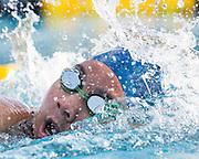 Freshman Vivian Le races the 100 freestyle during the swim meet against Newark Memorial at Milpitas High School in Milpitas, California, on February 27, 2015. (Stan Olszewski/SOSKIphoto)