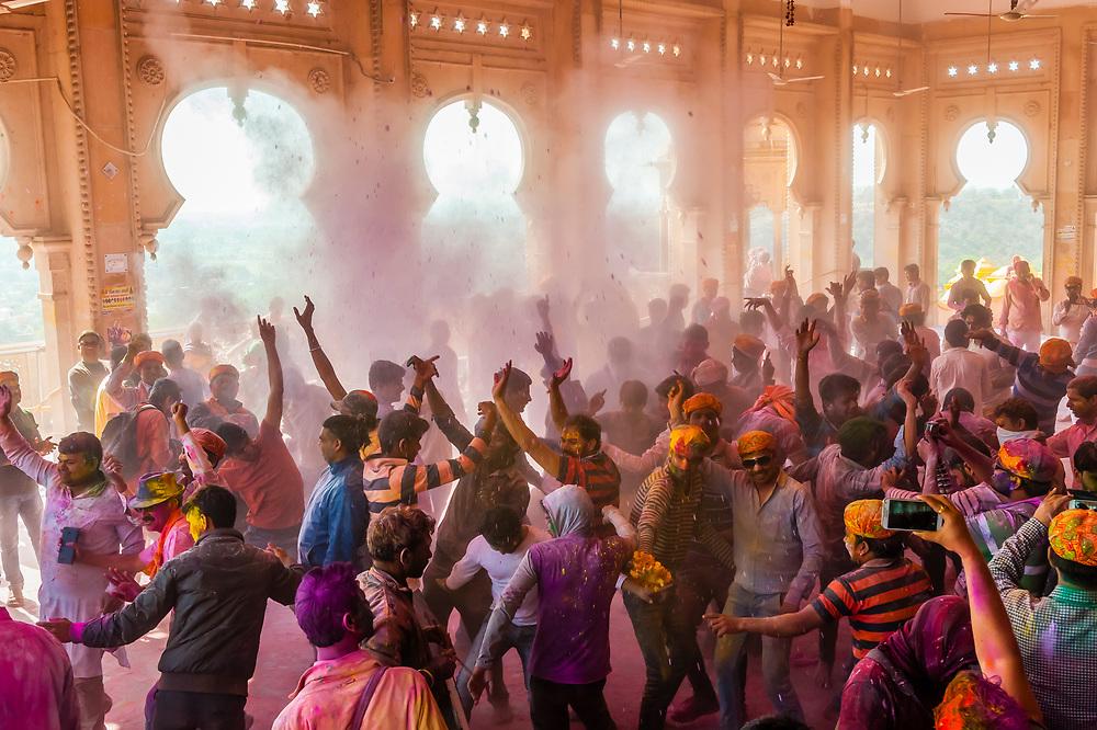 Dancing in the Shri Radha Rani Mandir (Hindu Temple),  Lathmar Holi (Holi, Festival of Colors), Barsana, near Mathura, Uttar Pradesh, India.