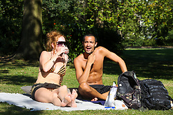 © Licensed to London News Pictures. 13/09/2020. London, UK. A couple enjoy warm and sunny weather in Finsbury Park, north London as mini heatwave hits London.<br /> <br /> ***Permission Granted***<br /> <br /> Photo credit: Dinendra Haria/LNP
