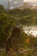 Tailani at dusk by the river next to the Forsfertil fertiliser factory, Cubatão