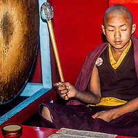 Tibetan Buddhist monks chant and play musical instruments during  a sacred puja ceremonyat Swayambhu Temple in the Kathmandu Valley, Nepal, 1986.