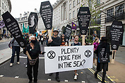 Extinction Rebellion activists highlight overfishing during the March for Nature on the final day of their two-week Impossible Rebellion on 4th September 2021 in London, United Kingdom. Extinction Rebellion are calling on the UK government to cease all new fossil fuel investment with immediate effect.