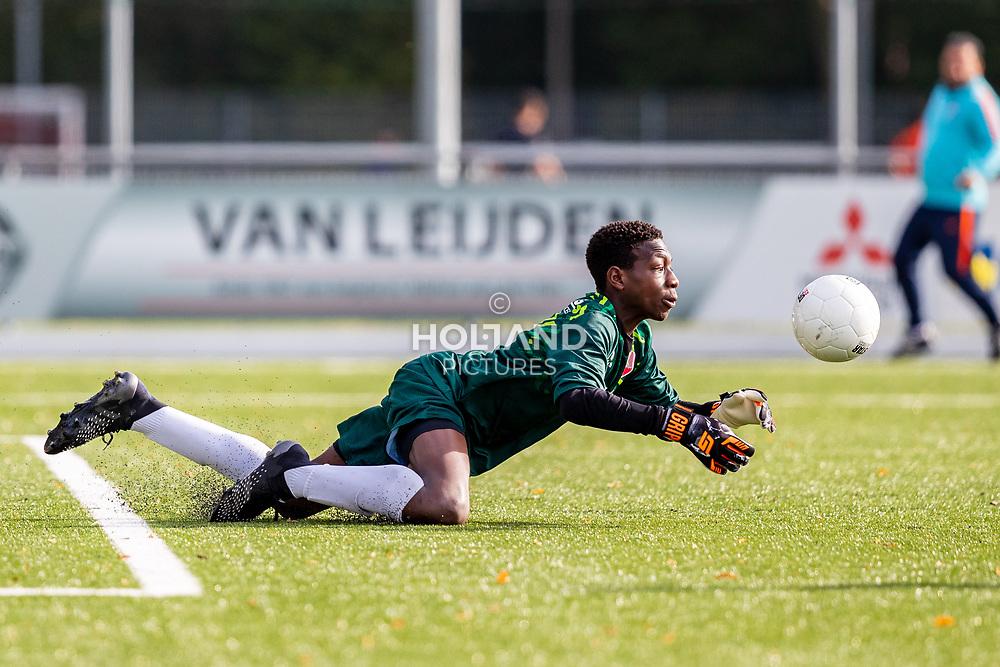 ALPHEN AAN DEN RIJN, NETHERLANDS - OCTOBER 2: #1 Tyron Chaar (Alphense Boys) during the Divisie 1 A NAJAAR u15 match between Alphense Boys and PSV at Sportpark De Bijlen on October 2, 2021 in Alphen aan den Rijn, Netherlands