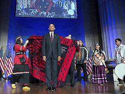 September 27, 2016 - Washington, DC, United States of America - U.S. President Barack Obama receives a ceremonial blanket given him by Mohegan Chief Lynn Malerba, left, and Brian Cladoosby, President of National Congress of American Indians, during the White House Tribal Nations Conference at the Mellon Auditorium September 26, 2016 in Washington, DC. (Credit Image: © Pete Souza/Planet Pix via ZUMA Wire)