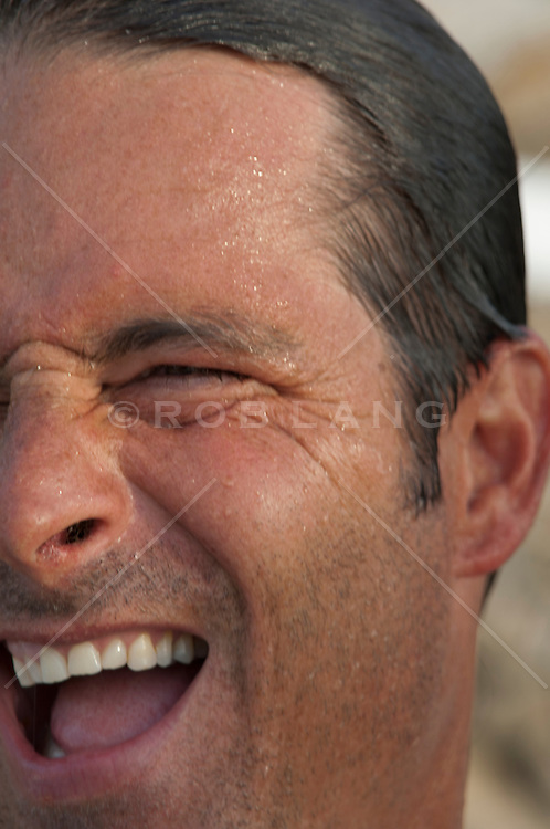 man with wet hair having a great laugh