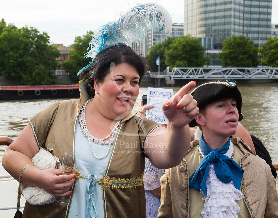 London, July 17th 2017. London Historians and Georgian Dining Academy celebrate the 300th anniversary of George Frederic Handel's masterpiece, The Water Music on the pleasure boat Golden Jubilee on the River Thames in London. PICTURED: Mayor of London's 'Night Tsar' Amy Lamé and her partner Jennie.