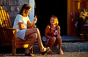 Young girls enjoy an ice cream cone in Rockland, Maine, USA