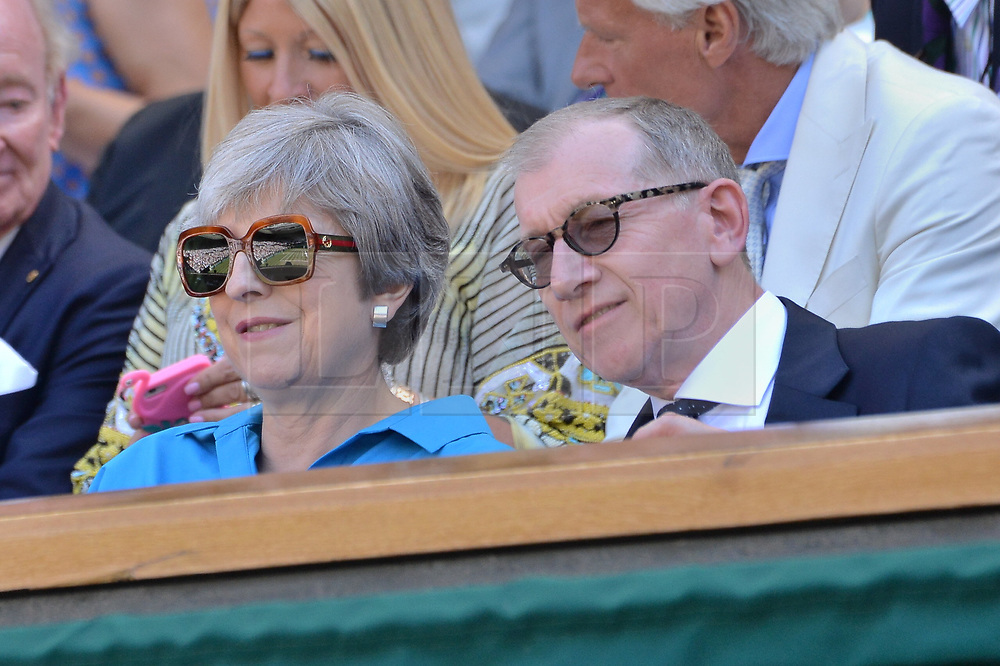 © Licensed to London News Pictures. 15/07/2018. London, UK. British prime minister Theresa May and Phillip May watch center court tennis in the royal box on the second day of the Wimbledon Tennis Championships 2018 held at the All England Lawn Tennis and Croquet Club. Photo credit: Ray Tang/LNP