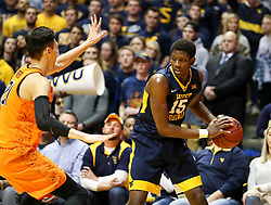 Feb 10, 2018; Morgantown, WV, USA; West Virginia Mountaineers forward Lamont West (15) looks to pass during the second half against the Oklahoma State Cowboys at WVU Coliseum. Mandatory Credit: Ben Queen-USA TODAY Sports