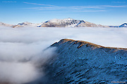 A phenomenal temperature inversion in North Wales, leaving only the summits of Snowdonia's hughest peaks in glaring sunshine above the cloud bank.