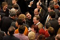 19 DEC 2003, BERLIN/GERMANY:<br /> Gerhard Schroeder (M), SPD, Bundeskanzler, zwaengt sich an Michael Hartmann, MdB, SPD, vorbei, um seine Stimmkarte in die Wahlurne zu werfen,  Sondersitzung des Bundestages zur Abstimmung ueber das Reformpaket zu Steuern und Arbeitsmarkt, Plenum, Deutscher Bundestag<br /> IMAGE: 20031219-01-058<br /> KEYWORDS: Gerhard Schröder