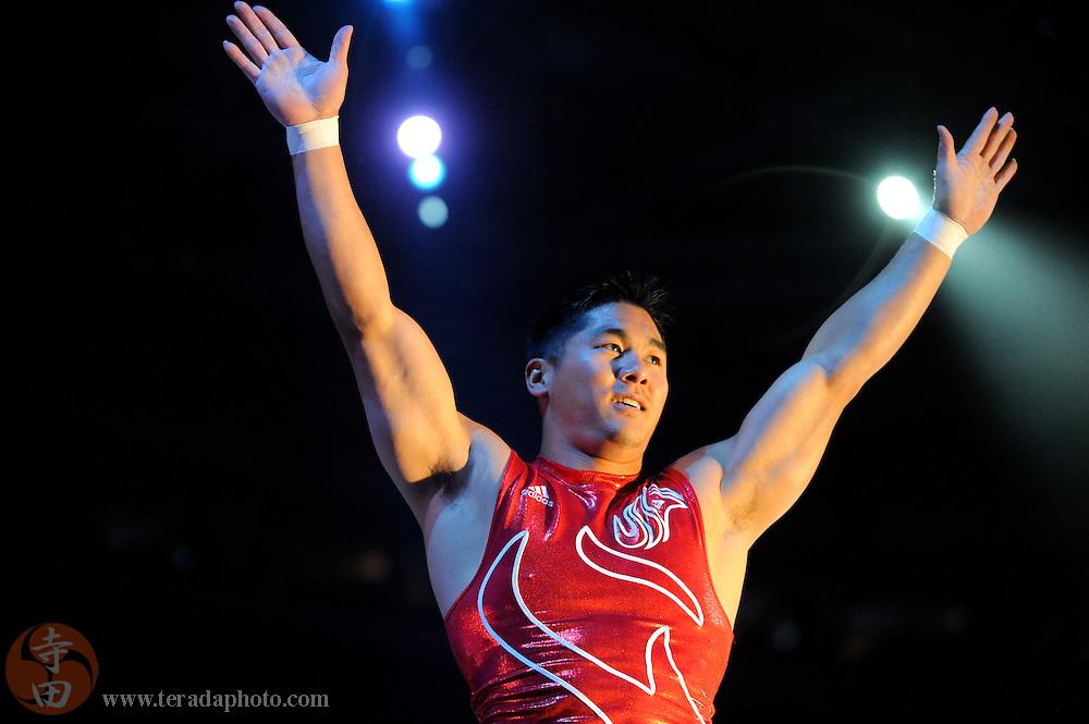 Sep 21, 2008; San Jose, CA, USA; Kevin Tan performs on the floor during the 2008 Tour of Gymnastics Superstars post-Beijing Olympic tour at HP Pavilion. Mandatory Credit: Kyle Terada-Terada Photo