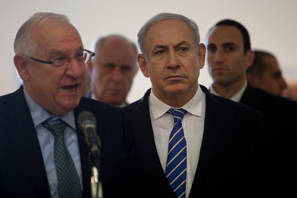 Speaker of the Knesset Reuven Rivlin (L) speaks as Israel's Prime Minister Benjamin Netanyahu (2nd R) looks on, as they attend the opening of a new exhibition commemorating the 50th anniversary of the verdict against Eichmann, at the Knesset, Israel's parliament in Jerusalem, on December 12, 2011. Eichmann, who was captured by Mossad operatives in Argentina and taken to Israel to face trial in an Israeli court, is considered responsible for the planning and execution of the Final Solution, Nazi Germany's plan and execution of the systematic genocide of European Jews during World War II, resulting in the murder of over six million Jews during the holocaust. Eichmann was found guilty and executed by hanging in 1962, he is the only person to have been executed in Israel on conviction by a civilian court.