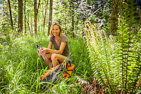 A portrait of a beautiful middle aged woman taking a break on a day hike in the Cascade mountains of Washington, USA.
