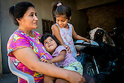 2014/11/23 – Quimili, Argentina: Felicita Carrizo, 44 spends time with her daughters Jenny Yedro (7) and Janet Yedro (2) at her home in allotment 4 of the Guaycurú Indigenous Community. The people in the area are being threaten by soy producers that see their land as an opportunity to grow more of the crop. On the otherhand indigenous defend a sustainable agriculture and to live in harmony with the nature. (Eduardo Leal)
