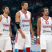 Turkey's Hidayet TURKOGLU (C), Omer ONAN (L) and Kerem TUNCERI (R) during their Istanbul CUP 2011match played Turkey between New Zeland at Abdi Ipekci Arena in Istanbul, Turkey on 24 August 2011. Photo by TURKPIX