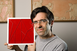 Stanford Classics professor Reviel Netz, author of a book on Archemedes. He is holding an Archemedes plastic puzzle.