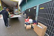 Nederland, The Netherlands, Rosmalen, 17-9-2015In de evenementenhal van het autotronl worden maximaal 400 vluchtelingen opgevangen, veelal afkomstig uit Syrië of Eritrea. In deze noodopvang wachten zij op doorstroming naar een azc en verdere afhandeling van hun asielaanvraag.In Holland the growing number of refugees forces the government to house them temporary and improvised in unused or empty buildings and halls. Often these are rented from private owners or real-estate firms such as this one. FOTO: FLIP FRANSSEN/ HH